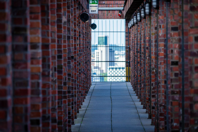 Architecture Brick Brick Wall Building Building Exterior Built Structure City Day Diminishing Perspective Direction No People Outdoors Safety Security Selective Focus The Way Forward Wall Wall - Building Feature Window