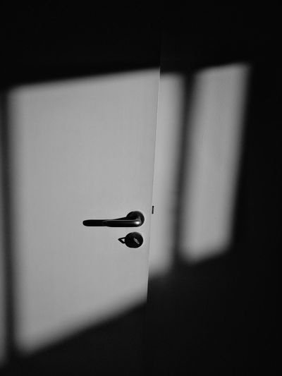 Close-up of sunlight falling on white door