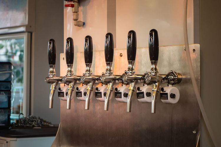 The craft beer taps in a pub