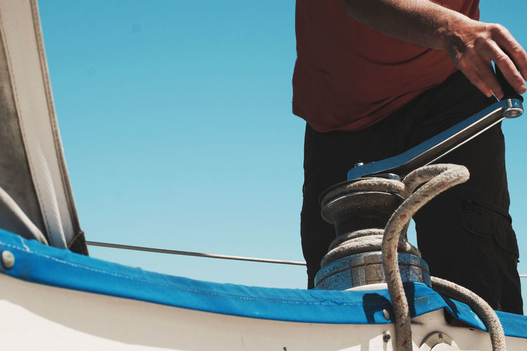 Close up on a man sailing a boat Bay Berkeley Marina Blue Boat California Clear Sky Close-up Day Human Hand Low Section Marina Men Mode Of Transport Nautical Vessel Ocean One Person Outdoors People Real People Sailing San Francisco Sky Transportation USA Let's Go. Together.