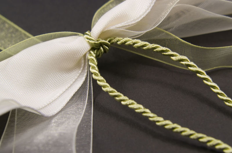 Close-up of rope tied up against black background