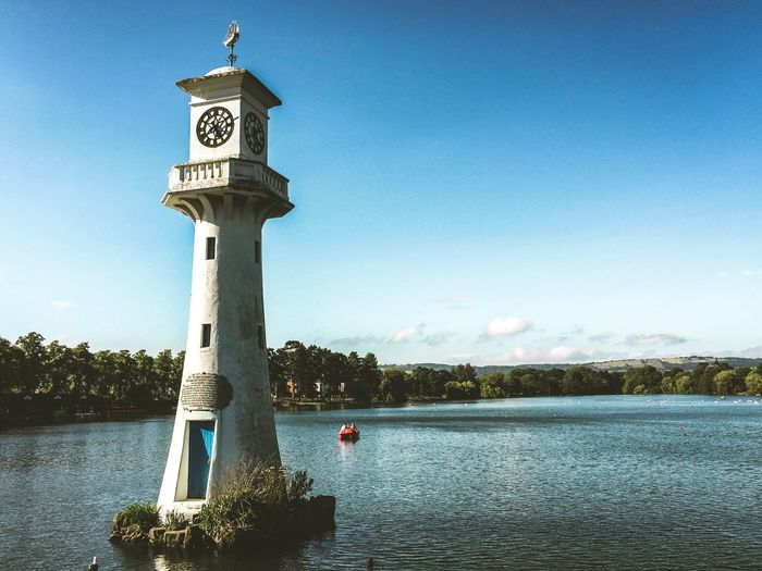 Roath Park Lake, in Cardiff. Water Day Blue Tranquility Lake Outdoors Scenics Sky Built Structure Lakeside Lake Cardiff Boat Clock Clock Tower Clock Face
