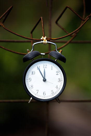 Clock Time Number Close-up Alarm Clock Focus On Foreground No People Minute Hand Instrument Of Time Hanging Clock Hand Hour Hand Clock Face Shape Day Plant Deadline 5 To 12 High Times Warning Climate Change Symbolism Blurred Background