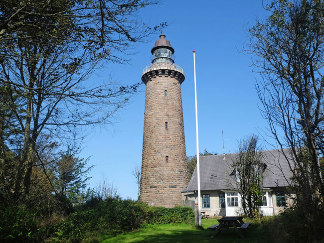 Lodbjerg Lighthouse in Thy National Park was built in 1883, is 35 m high and is still working. It is open during the day. Denmark Lodbjerg Fyr Architecture Guidance Lighthouse Safety Thy Tower