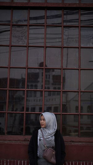 A women looking through window in building
