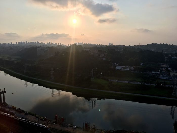 City River River Skyline Sãopaulo Skyline Water Sky Tree Plant Nature Sunset Beauty In Nature Architecture Scenics - Nature Sun Cloud - Sky Tranquility Tranquil Scene Environment No People Built Structure City