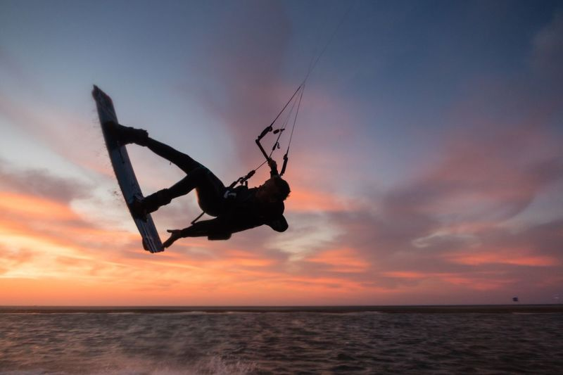 EyeEm Selects Sunset Sky Silhouette Sea Horizon Over Water Nature Cloud - Sky Scenics Leisure Activity Water Lifestyles Orange Color Beauty In Nature Real People Fun Beach Vacations Outdoors One Person Men Sunrise Action Sports Kitesurfing