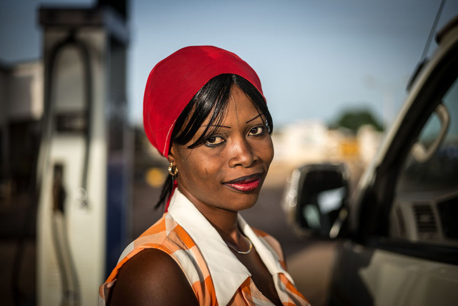 Filling Station Filling Up Filling Up The Tank Nigeria The Week on EyeEm Working Woman Africa Day To Day Focus On Foreground Headshot Looking At Camera Mode Of Transportation Motor Vehicle Petrol Station Portrait Portrait Of Working Woman Transportation