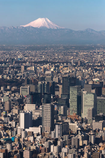 In the dozen or so times I have been though Tokyo I have only seen Fujisan once! This last trip the sky was clear so I headed up the sky tree to grab this shot looking over Tokyo. Mount Fuji or Fujisan is the highest mountain in Japan 3,776.24 m (12,389 ft). Honshu Island, Japan Cityscape Fujisan Japan Tokyo Sky Tree Tokyo,Japan Architecture Building Building Exterior Built Structure City City Life Cityscape Day High Angle View Mountain Nature No People Office Building Exterior Outdoors Residential District Sky Skyscraper Snowcapped Mountain Travel Destinations Volcano