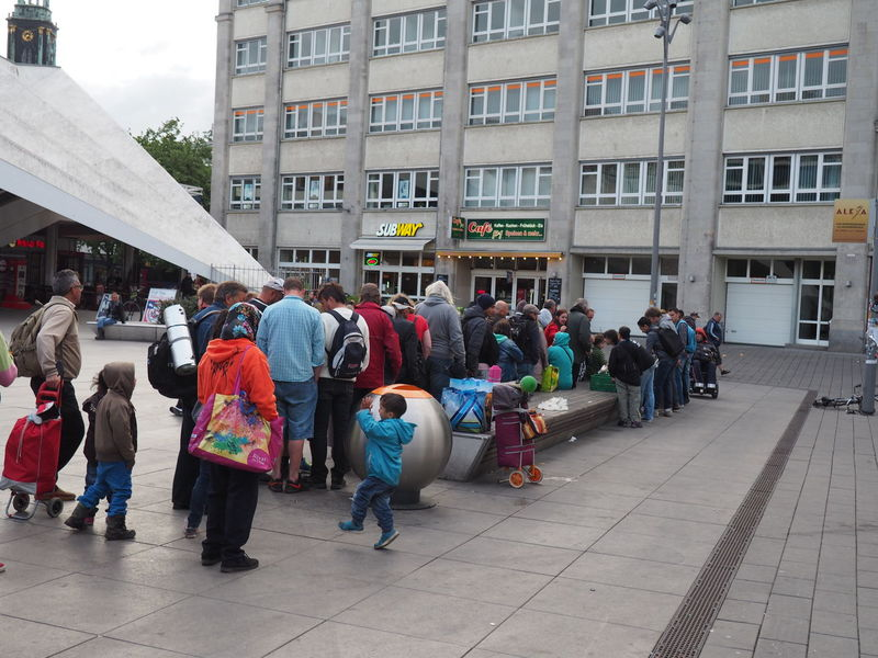 2016 Berlin City Life Family Food Distribution Giving Fod Helping Refugees Poverty Queuing Refugee Crisis Refugees Refugees Welcome Solidarity Street Life The Photojournalist - 2016 EyeEm Awards