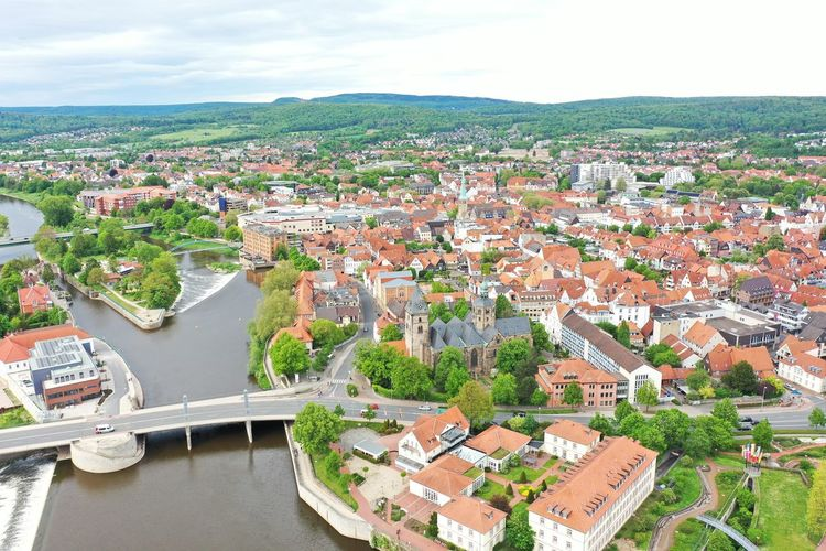 High angle view of townscape and river against sky