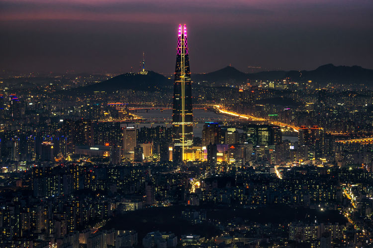 Night view over Seoul taken from Namhansanseong fortress. The view of Lotte tower lit up with the han river and namsan tower in the background City Cityscape Han River Korea Korean Night Lights Seoul Skyscrapers Travel Building Exterior Buildings Capital Capital City City Lights Crowded Illuminated Lotte Tower Night Night View Travel Destinations Urban Urban Landscape Urban Skyline Vintage