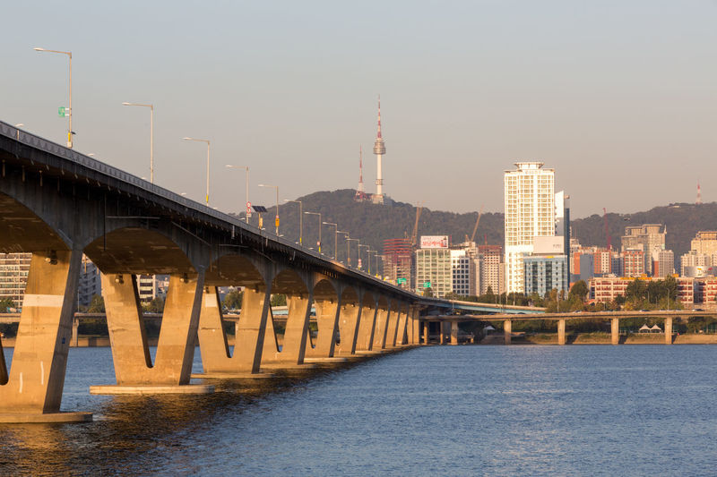 View over Han river to the city of Seoul, south Korea Han River Seoul Seoul, Korea Architecture Bridge - Man Made Structure Building Exterior Built Structure City Cityscape Connection Day Han River Bridge Nature No People Outdoors River Sky Skyscraper Transportation Travel Destinations Urban Skyline Water