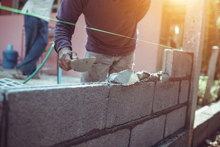 Man working on metal wall