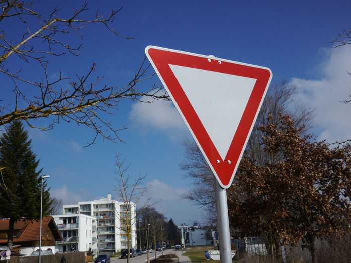 Trafficsign in south Germany Allgäu Guiding Traffic Architecture Bare Tree Building Exterior City Day Guidance Guide Nature No People Outdoors Red Road Sign Sky Traffic Sign Tree