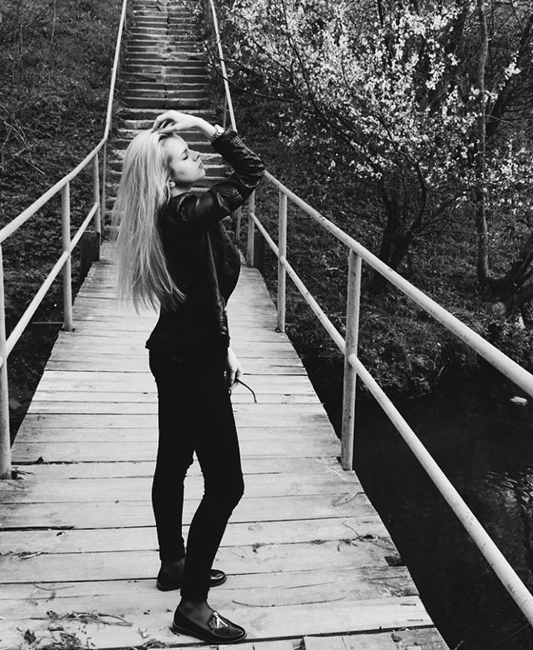 one person, full length, real people, railing, leisure activity, casual clothing, young adult, day, outdoors, young women, lifestyles, footbridge, beautiful woman, standing, portrait, tree, nature, adult, people