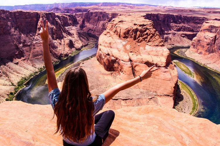 Horse shoe bend Adult Beauty In Nature Hair Hairstyle Holiday Horse Shoe Bend Leisure Activity Lifestyles Mountain Mountain Range Nature Non-urban Scene One Person Outdoors Page Real People Rear View Rock Rock - Object Rock Formation Scenics - Nature Solid Travel Destinations Vacations Women