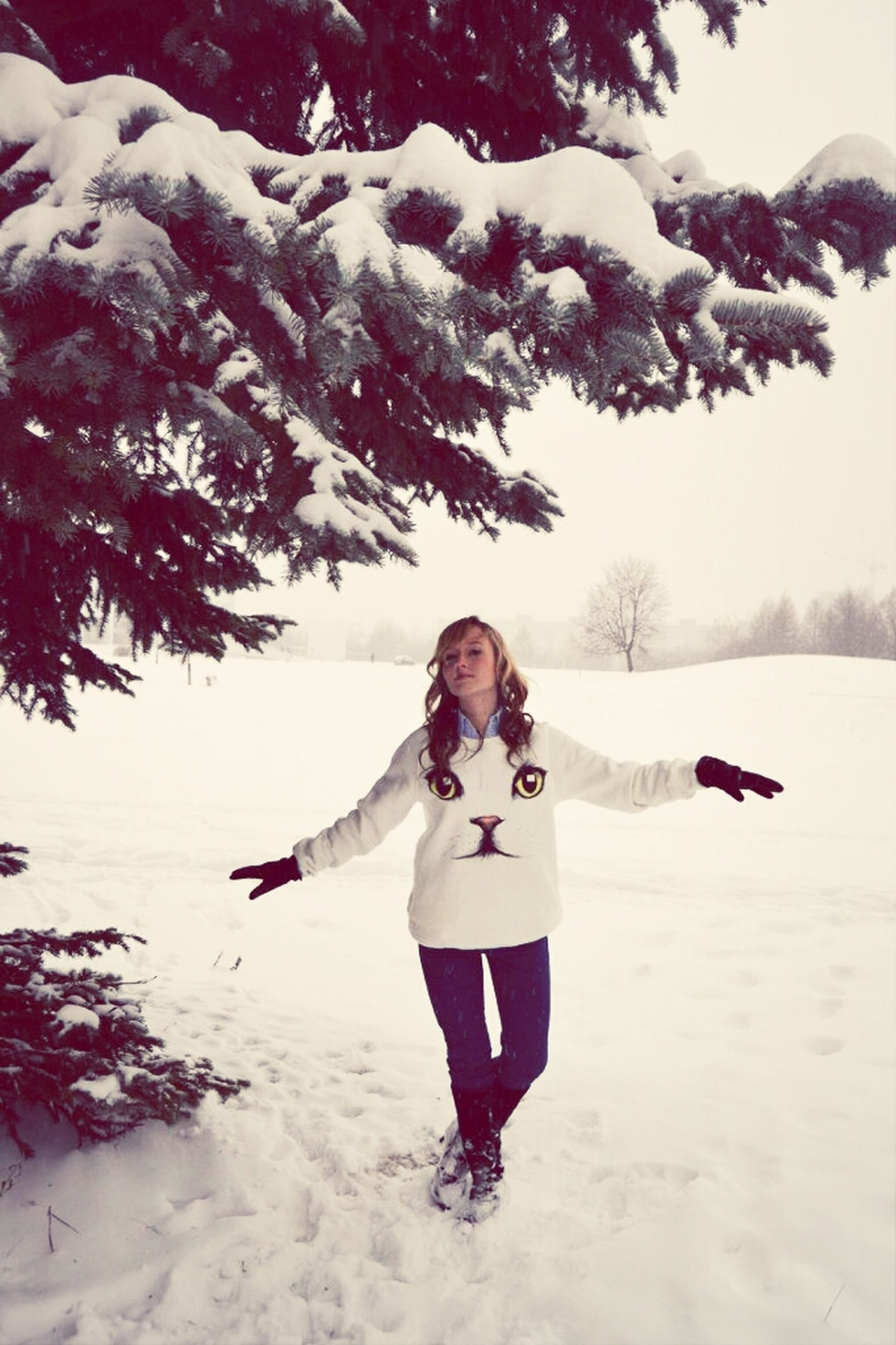 snow, winter, cold temperature, season, lifestyles, leisure activity, weather, full length, warm clothing, vacations, person, white color, young adult, enjoyment, nature, tree, beauty in nature, young women
