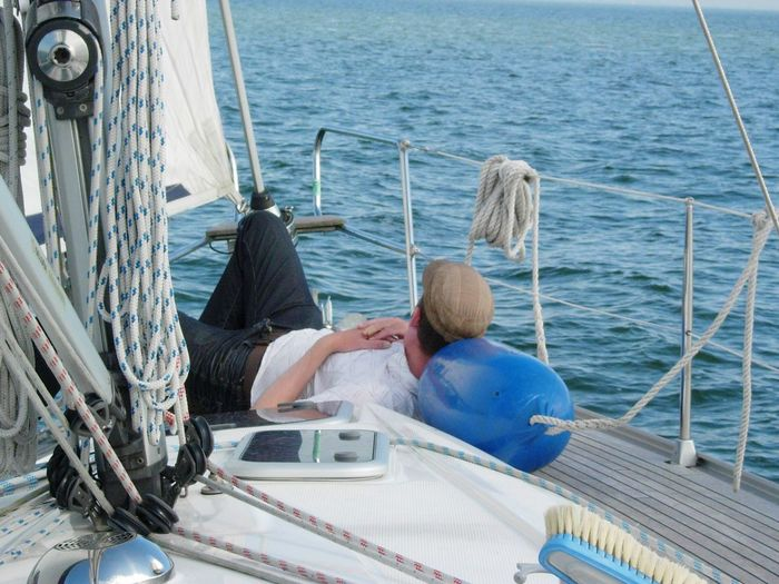 Man Relaxing On Boat At Sea
