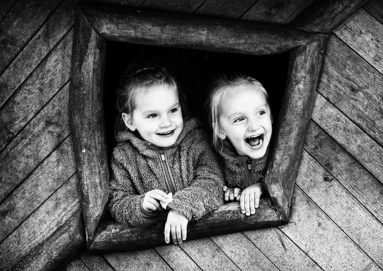 Happy Window Children Emotions Family Fun Kids Kids Being Kids Laughing Sisters Child Childhood Children Only Emotion Girls Happiness Kid Looking At Camera Playing Portrait Positive Emotion Sister Smiling Togetherness Twin Twins Window EyeEmNewHere The Portraitist - 2018 EyeEm Awards