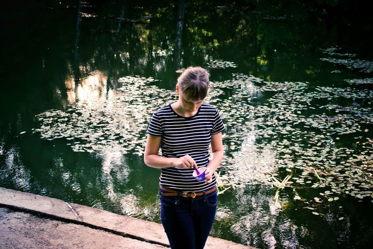 Water One Person People Outdoors Youth Of Today Reflection Ice Cream Beauty In Nature Lifestyles Summer Park Lake Nature Sunlight Pond Water Reflections Light And Shadow Girl Evening Outdoor Photography Calm Water Calming Place Young Adult Casual Clothing Day