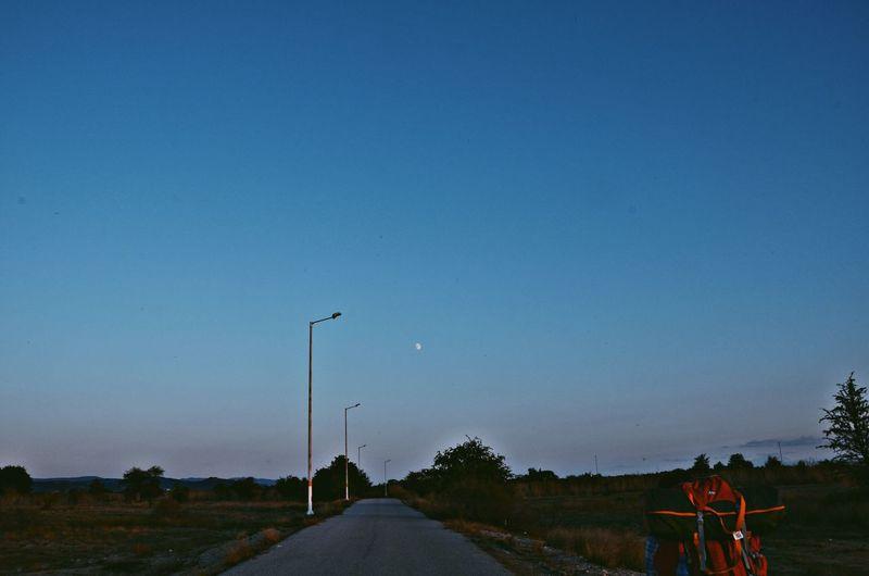 Street against clear blue sky