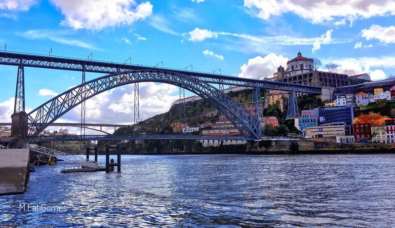 Porto is blue ... that's true ... 😉💙 __________________________________ Bridge - Man Made Structure Architecture Cloud - Sky City Sky Built Structure River Travel Destinations Transportation Building Exterior Outdoors Water Connection Day No People Suspension Bridge Cityscape Sun_collection, Sky_collection, Cloudporn, Skyporn Porto