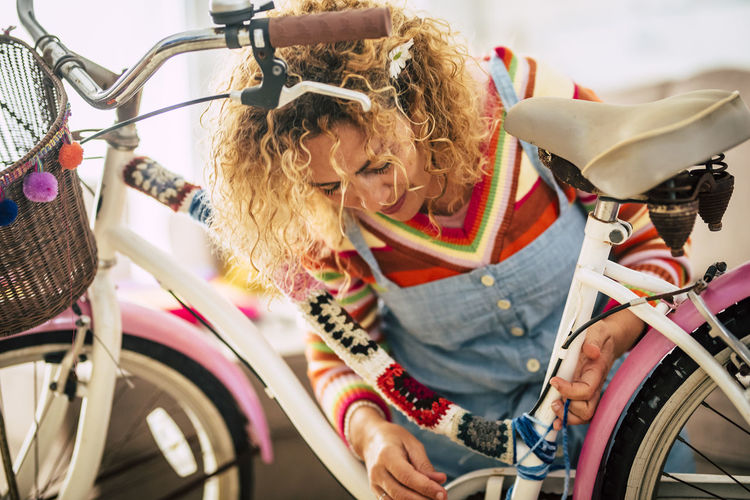 Smiling woman with bicycle outdoors