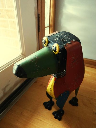 Door Stopper Decoration Dog Metal Work Colors Waiting Looking Out Of The Window Rustic Light House Decoration Close-up Door Entryway EyeEmNewHere