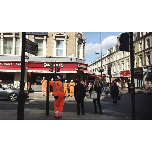 Men Waiting Traffic Lights Man Standing At The Traffic Lights Construction Worker Orange Orange Is The New Black Urban Encounters Standing There Line-up People Photography Urban Scene Lerone-frames Walking Among Us Relaxing Helmet Wearing Hats Right To Bear Arms
