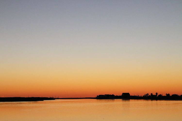 Architecture Beach Life Beauty In Nature Matagorda Bay Nature No People Outdoors Sargent Scenics Sea Sky Sunset Texas Texas Landscape Texas Landscape Texas Skies Texas Sky Texas Sunset Tranquil Scene Tranquility Water Waterfront