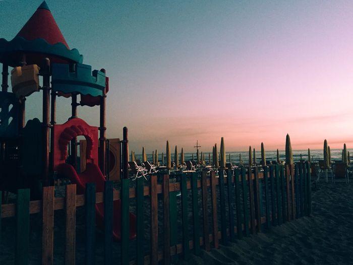 Lifeguard hut at beach during sunset