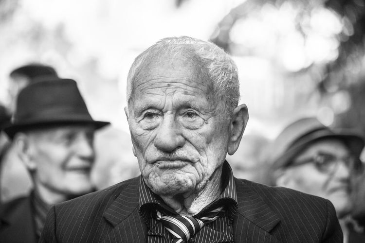 Veteran of World War II is attending the event dedicated to them. Each of the Veterans are more then 95 years old. The Portraitist - 2018 EyeEm Awards Adult Close-up Clothing Contemplation Day Focus On Foreground Front View Headshot Human Face Lifestyles Looking Looking At Camera Males  Men People Portrait Real People Senior Adult Senior Men Wrinkled
