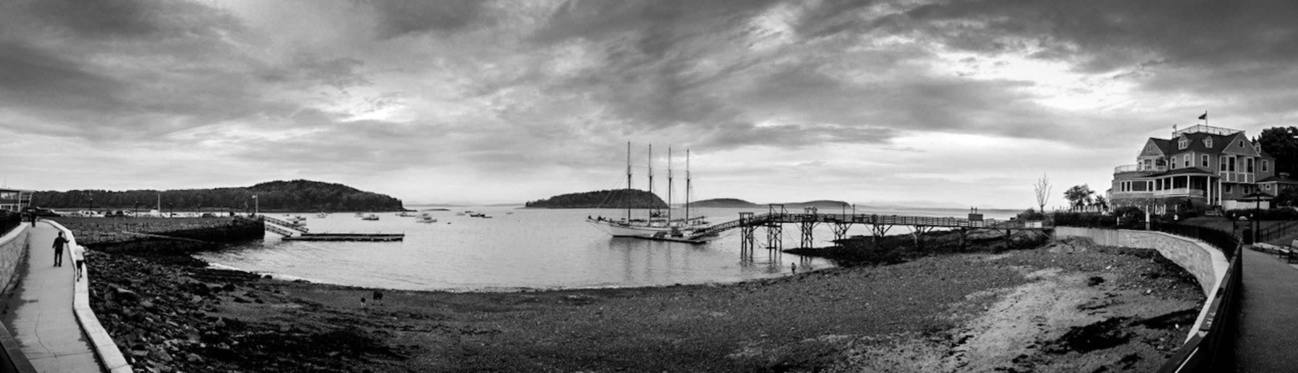 sky, water, architecture, built structure, sea, cloud - sky, nautical vessel, building exterior, cloudy, transportation, moored, beach, cloud, boat, mode of transport, shore, panoramic, harbor, day, nature