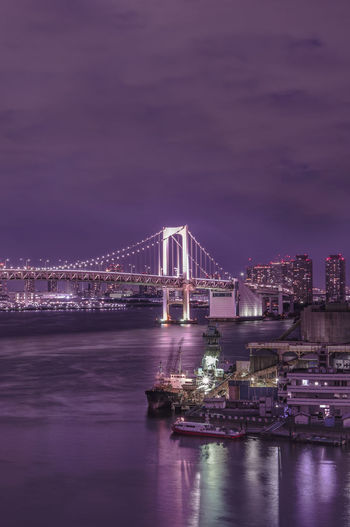 Circular highway leading to the rainbow bridge in odaiba bay of tokyo.