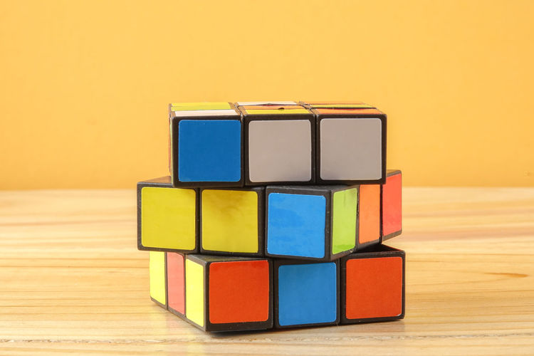 RUBIK'S CUBE , CREATIVITY TOY Creativity Rubik Cube Block Blue Choice Close-up Design Focus On Foreground Geometric Shape Indoors  Intelligence Multi Colored No People Rubik Shape Stack Still Life Studio Shot Table Toy Toy Block Variation Wood - Material