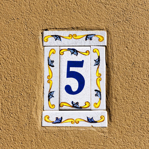 Close-up of number sign on wall