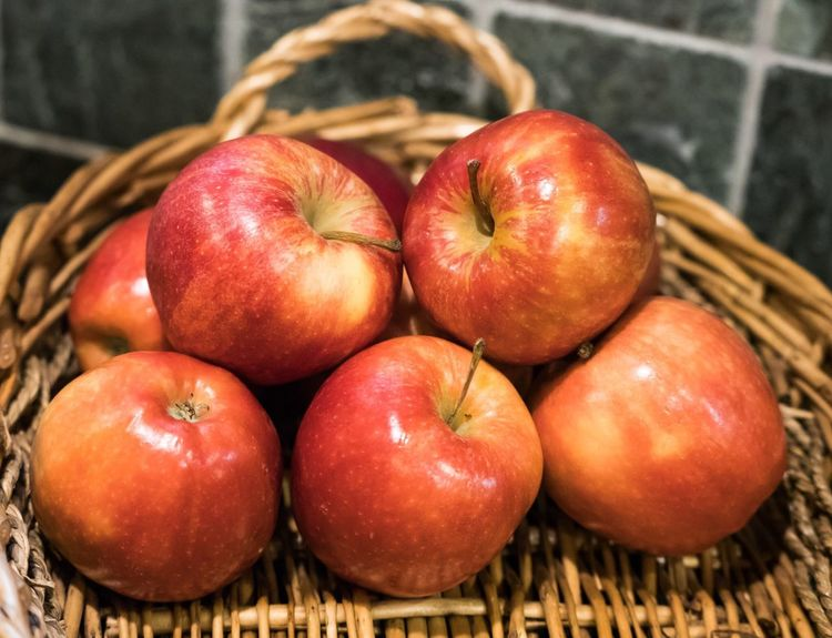 An apple a day! Basket of red apples. Seasonal Harvest Growing Pesticides GMO Organic Fresh Ripe Picnic Red Apples Healthy Apple A Day Wicker Basket Fruit Apples EyeEmNewHere EyeEmNewHere EyeEmNewHere