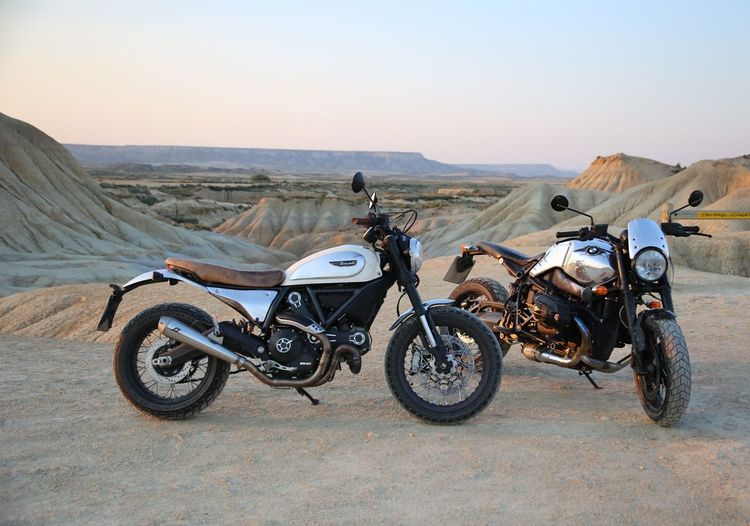 two bikes in the desert Motorcycle Bmw Motorcycle Bmw Ducati Rninet Scrambler Ducatiscrambler Bardenas Reales EyeEm Selects Desert Arid Climate Transportation Motorcycle Sand Landscape Adventure Day Nature Outdoors Scenics Clear Sky Off-road Vehicle Road Trip