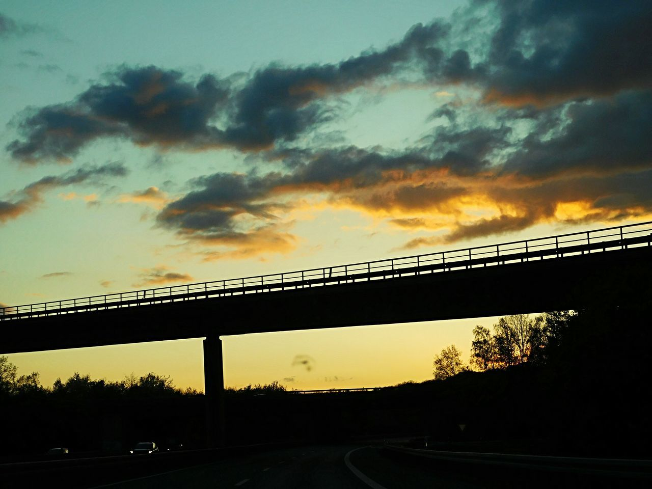 bridge - man made structure, connection, transportation, sunset, engineering, built structure, sky, silhouette, architecture, cloud - sky, no people, road, nature, tree, outdoors, day