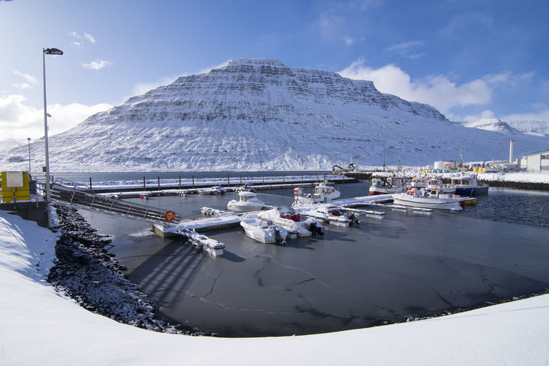 Eskifjordur port with ship the lovely fisherman village in the east fjord of Iceland. Eskifjordur Fishing Village Industry Transportation Beauty In Nature Cloud - Sky Cold Temperature Mountain Mountain Range Nature Nautical Vessel No People Outdoors Port Salt - Mineral Scenics Sky Snow Snowcapped Mountain Tranquil Scene Tranquility Travel Destinations Water Wimter Winter
