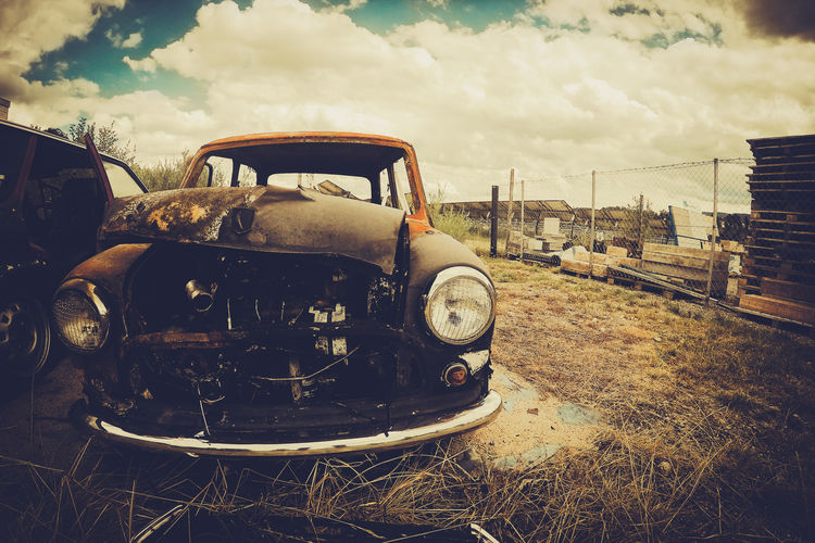 Abandoned Bad Condition Burn Car Damaged Day No People Obsolete Outdoors Retro Car Sky Transportation