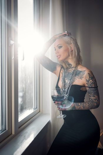 Portrait Photography Portrait Of A Woman Portrait One Person Indoors  Real People Home Interior Drinking Leisure Activity Drink Sunlight Blond Hair Wineglass Wine Lifestyles Sitting Young Adult Beautiful Woman Young Women Day People