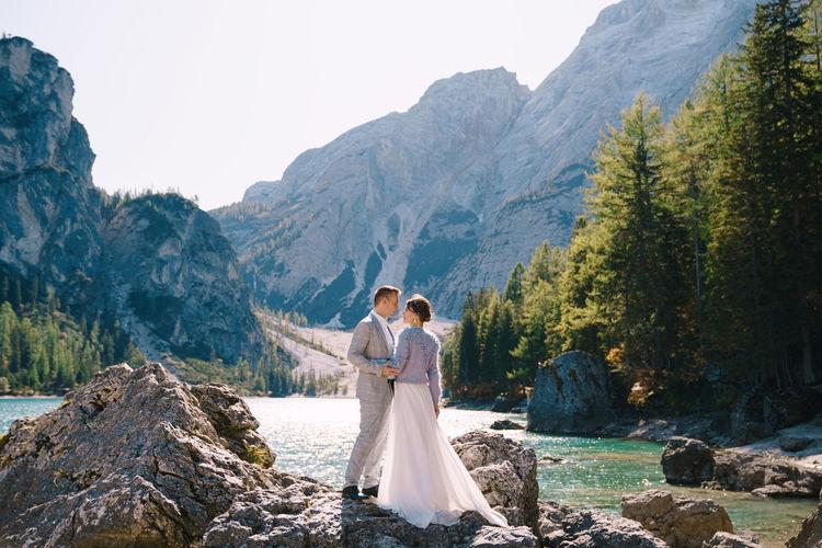 Couple kissing on mountain against mountains