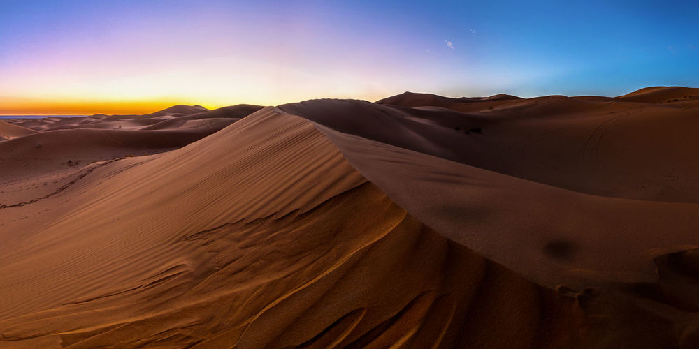 Sahara at dawn Ergchebbi Morocco Beauty In Nature Desert Environment Extreme Terrain Geology Landscape Merzouga Nature No People Non-urban Scene Outdoors Sahar Sand Sand Dune Scenics Tranquil Scene Tranquility Travel Destinations