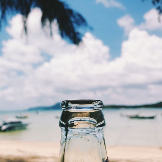 Water Sky Cloud - Sky Glass - Material Nature Focus On Foreground Sea Transparent No People Food And Drink Day Bottle Beach Refreshment Beauty In Nature Close-up Container Outdoors Drink Glass