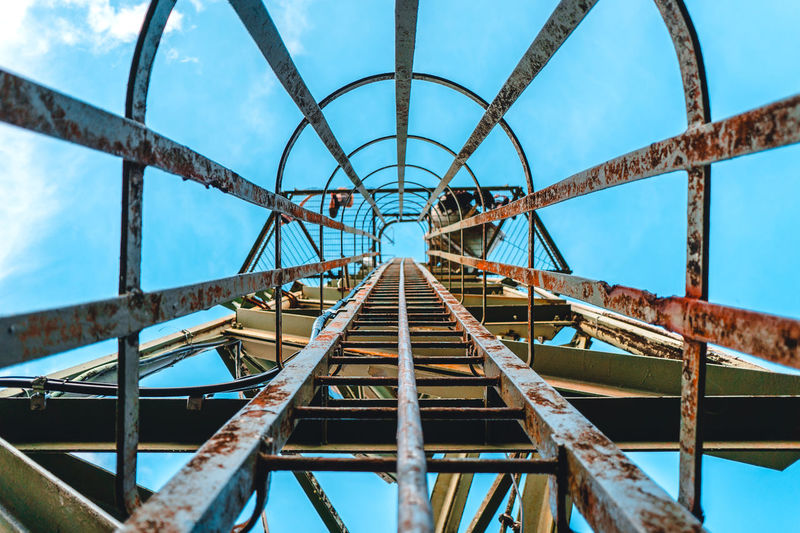 There is only one way to get up there Architecture Bridge - Man Made Structure Built Structure Climbing Connection Day Girder Ladder Low Angle View Metal No People Outdoors Radio Tower Rust Sky Sky And Clouds Transportation Underneath