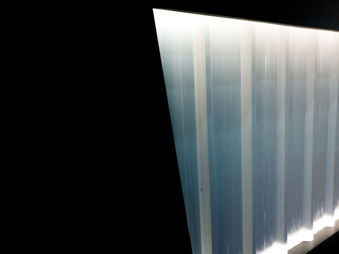 Close-up of illuminated window against sky