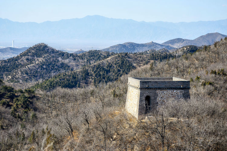 A fragment of the Great Chinese Wall in the mountains near Bejing. ASIA Ancient Badaling Beijing Panorama Border Brick China Culture Forest Hill History Landscape Miracle Mountain Tourism Unesco Unesco World Heritage Wonder