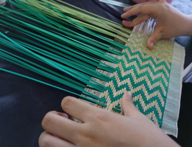 High angle view of person weaving on table